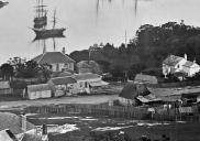 , This detail from Charles Bayliss' 1875 panorama of Sydney Harbour shows timber and stone cottages of the sort that would have characterised the area from the 1850s. State Library of New South Wales